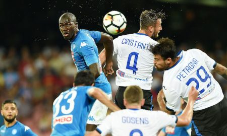 NAPLES, ITALY - AUGUST 27: Player of SSC Napoli Kalidou Koulibaly vies with Atalanta BC player Bryan Cristante during the Serie A match between SSC Napoli and Atalanta BC at Stadio San Paolo on August 27, 2017 in Naples, Italy.  (Photo by Francesco Pecoraro/Getty Images)